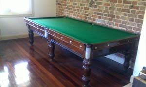 pool table removalists moving a 9 foot 3/4 size pool table